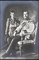 BNPS.co.uk (01202 558833)<br /> Pic: HAldridge/BNPS<br /> <br /> Alexei and Nicholas.<br /> <br /> Poignant photographs of the last Russian royal family visiting their British relatives - the King and Queen of Britain - have come to light.<br /> <br /> The black and white images show Tsar Nicholas II, his wife Alexander and their children at Osborne House on the Isle of Wight in 1909 with Edward VII and his wife, Mary of Teck.<br /> <br /> The images show just how close the two Royal families were. <br /> <br /> The album of up to 100 photo postcards is being sold for &pound;1,500 by Henry Aldridge and Son.
