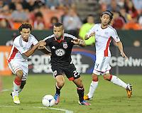 D.C. United forward Maicon Santos (29) goes against New England Revolution defender Kevin Alston (30) D.C. United defeated The New England Revolution 2-1 at RFK Stadium, Saturday September 15, 2012.