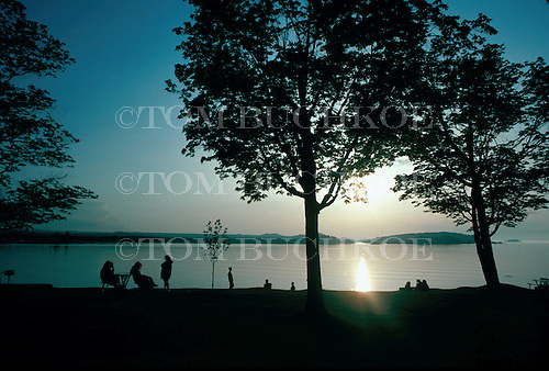 Picnickers enjoy the sunset at Presque Isle Park, Marquette, Michigan, Lake Superior.