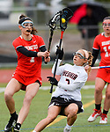 CHESHIRE, CT-042517JS12- Cheshire's Vicki Palmer (7) tries to get a shot off while being defended by Branford's Haley Maercklein (7) during their game Tuesday Cheshire High School. <br /> Jim Shannon Republican-American