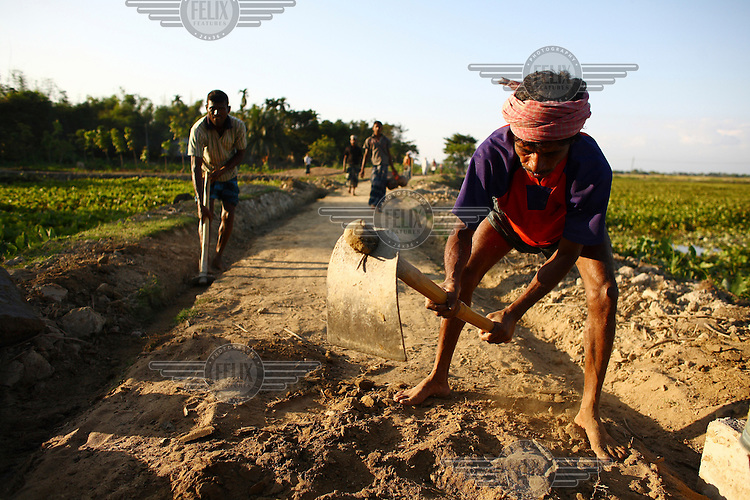 A road is constructed with the help of IFAD (International Fund for Agricultural Development) funds.