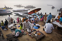 Pilgrims at Varanasi's ghats after bathing in the sacred Ganges river. The ghats attract millions of Hindu pilgrims from across India every year. ..Photo: Tom Pietrasik.Varanasi, India.March 5th 2008.