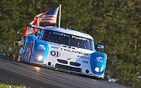 The #01 BMW Riley of Memo Rojas and Scott Pruett races to victory in the EMCO Gears Classic Grand American Road Racing Rolex Sports Car Series at Mid-Ohio Sports Car Course, In Lexington, Ohio, June 2010.  (Photo by Brian Cleary/www.bcpix.com)