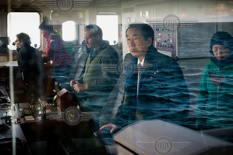 Naoto Kan (Prime Minister of Japan during the Fukushima nuclear accident) on board the Greenpeace Rainbow Warrior sailing off the coast of Fukushima calling for the closure of all nuclear reactors in Japan.  On 11 March 2011 a magnitude 9 earthquake struck 130 km off the coast of Northern Japan causing a massive tsunami that swept across the coast of Northern Honshu damaging the Fukushima Daiichi nuclear power plant and triggering the worst nuclear accident since Chernobyl.