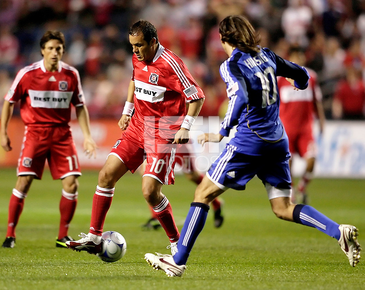 Chicago Fire midfielder Cuauhtemoc Blanco (10) makes a back heel pass in front of Kansas City Wizards midfielder Santiago Hirsig (10).  The Chicago Fire tied the Kansas City Wizards 2-2 at Toyota Park in Bridgeview, IL on April 18, 2009.