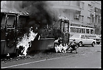 An anti-Shah demonstrator sets a bus afire in downtown Tehran. December 26, 1978.