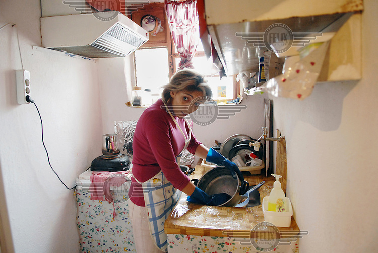 38 year old Sister Eti washes dishes in the kitchen in her home. Eti is an Iranian refugee. She moved to Turkey because she wanted to become a Christian. Eti says under Islamic law in Iran she would be put to death if she did this. Eti hopes by telling her story she and other women in her situation will be helped.
