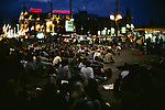 People In Square At Night
