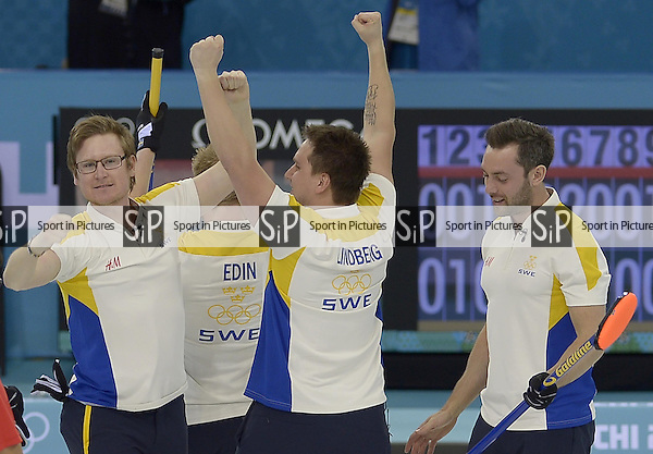 The Swedish team celebrate. (l to r)Viktor Kjaell (SWE), Niklas Edin (SWE, skip), Fredrik Lindberg (SWE) and Sebastian Kraupp (SWE, vice skip). Mens curling - Bronze medal match - SWE v CHN - Ice Cube Curling Centre - Olympic Park - PHOTO: Mandatory by-line: Garry Bowden/SIPPA/Pinnacle - Photo Agency UK Tel: +44(0)1363 881025 - Mobile:0797 1270 681 - VAT Reg No: 768 6958 48 - 210214 - 2014 SOCHI WINTER OLYMPICS - Ice Cube Curling Centre, Sochi, Russia