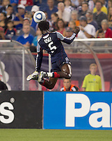 New England Revolution defender Emmanuel Osei (5) gets some height as he heads the ball away. The New England Revolution defeated DC United, 1-0, at Gillette Stadium on August 7, 2010.