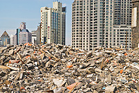 Rubble of destroyed building with newly build apartments in Background, Shangai, China