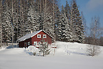 Red Wooden House and Snowy Landscape at Marguse, Valga County, Estonia
