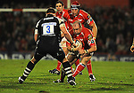 Iestyn Thomas charges at Darren Crompton. Scarlets V Bristol, EDF Energy Cup  © Ian Cook IJC Photography iancook@ijcphotography.co.uk www.ijcphotography.co.ukUnholy Alliance Tour 2008,