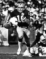 Raider QBJim Plunkett scrambles..photo by Ron Riesterer