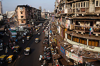 A bazaar lined by chawl (tenements) in Mumbai, India. Photo by Suzanne Lee