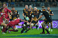 Michael Leitch passes to Sam Cane during the Super Rugby match between the Chiefs and Reds at Yarrow Stadium in New Plymouth, New Zealand on Saturday, 6 May 2017. Photo: Dave Lintott / lintottphoto.co.nz