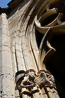 Low angle view of tracery and sculpted capitals in the cloister of Monestir de Santes Creus, Aiguamurcia, Catalonia, Spain, pictured on May 21, 2006, in the morning. This capital depicts a fabulous winged creature. The Cistercian Reial Monestir Santa Maria de Santes Creus and its church were built between 1174 and 1225. Following strict Cistercian rule, the Romanesque complex originally featured no architectural embellishments with the exception of ornamented capitals and crenellations on the rooflines. In the 13th century the cloister was converted in Gothic style by James II of Aragon. Picture by Manuel Cohen.