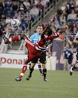 FC Dallas defender Jair Benitez(5) leaps to intercept a pass.  The New England Revolution drew FC Dallas 1-1, at Gillette Stadium on May 1, 2010