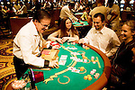Blackjack table in las Vegas, Nevada, Caesars Palace and Casino, gaming, gambling, chips, blackjack, betting croupier, blackjack players, model released, blackjack table, cards, NV, Las Vegas, Photo nv245-17155..Copyright: Lee Foster, www.fostertravel.com, 510-549-2202,lee@fostertravel.com