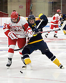 Jill Cardella (BU - 22) and Laurel Ansell (Windsor - 22) battle to reach the puck. - The Boston University Terriers defeated the visiting University of Windsor Lancers 4-1 in a Saturday afternoon, September 25, 2010, exhibition game at Walter Brown Arena in Boston, MA.