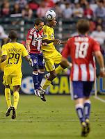 Chivas USA forward Giancarlo Maldonado (20) battles Columbus Crew defender Andy Iro (6) in the air. CD Chivas USA defeated the Columbus Crew 3-1 at Home Depot Center stadium in Carson, California on Saturday July 31, 2010.