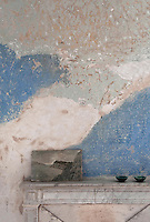 Distressed plaster is a feature of the original convent walls in the living room