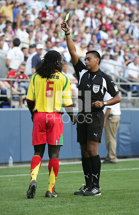 Referee Walter Lopez issues a yellow card to Jason James. USA defeated Grenada 4-0 during the First Round of the 2009 CONCACAF Gold Cup at Qwest Field in Seattle, Washington on July 4, 2009.