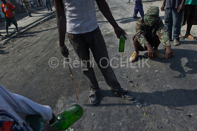 © Remi OCHLIK/IP3 - Cap Haitien on 2010 november 15 - Anti-U.N. protests in cities of Cap-Haitien  Protesters accuse Nepalese of bringing cholera to Haiti.Incidents raise security questions ahead of elections ..In Haiti's second city of Cap-Haitien in the North, hundreds of protesters yelling anti-U.N. slogans hurled stones at U.N. peacekeepers, set up burning barricades and torched a police station