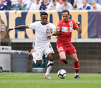 Robbie Findley (27) of the USMNT fights for the ball with Tuncay Sunli (10) of Turkey at Lincoln Financial Field in Philadelphia, PA.  The USMNT defeated Turkey, 2-1.