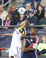 Columbus Crew substitute forward Aaron Schoenfeld (18) and New England Revolution defender Andrew Farrell (2) battle for head ball.  In a Major League Soccer (MLS) match, the New England Revolution (blue) defeated Columbus Crew (white), 3-2, at Gillette Stadium on October 19, 2013.