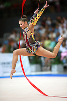 Alina Kabaeva of Russia leaps with ribbon during event finals at 2007 Portimao World Cup of Rhythmic Gymnastics on April 29, 2006.  (Photo by Tom Theobald)..