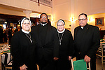 """Southington, CT- 04 February 2017-020417CM18-  Social Moments--- From left, Sister Mariette Moan, ascj. with the Archdiocese of Hartford, Father George Mukuka with The Church of St. Timothy of West Hartford, Sister Mary Grace Walsh, ascj and Father James Shanley both with the Archdiocese of Hartford, are photographed during the """"A Night in Havana"""" the 26th annual Gala put on by Saint Mary's Hospital Aqua Turf in Southington.   Christopher Massa Republican-American"""