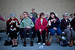 Members of Tortolita, Northminster, and St. Andrew's Presbyterian gather for a public candlelight vigil at St. Andrew's Presbyterian Church just two blocks from the scene of the shooting.  One of the septuagenarian victims of the shooting was a member of the Northminster congregation....  Scenes from Tucson, Arizona in the days following a mass shooting that left six dead and [number] injured.  The shooter, identified as Jared Loughner, was captured at the scene and charged in federal court on January 9th, 2011.  Among the injured was democratic congresswoman Gabrielle Giffords.  The dead included a federal judge, a nine year-old girl, and several septaugenarians who had all come to see the congresswoman at one of her 'Congress on the Corner' events.