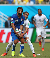 Martin Caceres of Uruguay wrestles the match ball from Andrea Pirlo of Italy