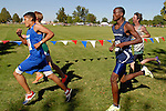 Nyssa senior Jaimie Venegas, Mountain View junior Ejide Muvange, and Victory Charter sophomore Conrad Larson on the second loop during the NNU Invite at West Park in Nampa, ID on September 11, 2010.