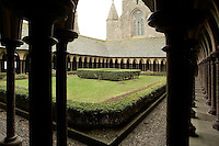 40 metres above the rock, the Cloister with its double row of frail looking arches on the garden side, the columns, set in a quincunx pattern linked at the top by diagonal arches form a series of stable tripods supporting the roof, the Merveille (Marvel), 13th century, thanks to a donation by the king of France, Philip Augustus who offered Abbot Jourdain, a grant for the construction of a new Gothic-style architectural set, Le Mont Saint Michel, Manche, Basse Normandie, France. Picture by Manuel Cohen