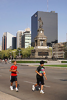 Joggers on Paseo de la Reforma in Mexico City