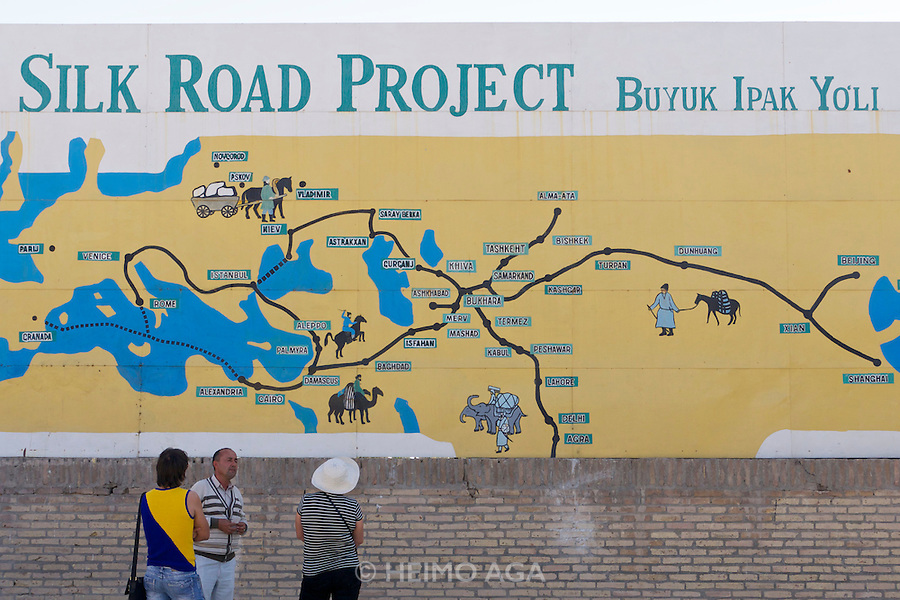 Uzbekistan, Khiva. West gate. Silk Road Information Billboard.