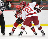 Aaron Bogosian (St. Lawrence - 32), Marshall Everson (Harvard - 21) - The Harvard University Crimson defeated the St. Lawrence University Saints 4-3 on senior night Saturday, February 26, 2011, at Bright Hockey Center in Cambridge, Massachusetts.