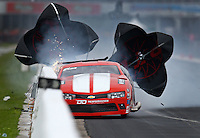 Apr 29, 2016; Baytown, TX, USA; NHRA  pro mod driver Jonathan Gray loses control after blowing a rear tire and hits the wall during qualifying for the Spring Nationals at Royal Purple Raceway. Gray was uninjured. Mandatory Credit: Mark J. Rebilas-USA TODAY Sports