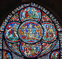 Centre: a statue of Our Lady of Chartres with 4 angels; top: 2 thurifer or incense-bearer angels above the Virgin; right and left: 2 prophets hold phylacteries; bottom: the bishops Yves of Chartres and Fulbert, Fulbert holds a model of the new cathedral. Top medallion of the Miracles of Our Lady stained glass window, 1200, depicting the Glorification of the Virgin, in the nave of Chartres Cathedral, Eure-et-Loir, France. This window was destroyed in 1816 and restored in 1927 under Lorin. Chartres cathedral was built 1194-1250 and is a fine example of Gothic architecture. Most of its windows date from 1205-40 although a few earlier 12th century examples are also intact. It was declared a UNESCO World Heritage Site in 1979. Picture by Manuel Cohen