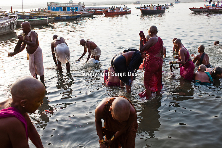 Hindu pilgrims offer prayers and bathe on the ghats in the ancient city of Varanasi in Uttar Pradesh, India. Photograph: Sanjit Das/Panos