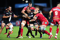 Schalk Burger of Saracens takes on the Scarlets defence. European Rugby Champions Cup match, between Saracens and the Scarlets on October 22, 2016 at Allianz Park in London, England. Photo by: Patrick Khachfe / JMP