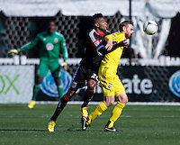 Lionard Pajoy (26) of D.C. United runs into the back of Eddie Gaven (12) of the Columbus Crew during the game at RFK Stadium in Washington, DC.  Columbus Crew defeated D.C. United, 2-1.