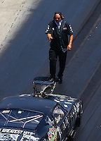 Jun 18, 2016; Bristol, TN, USA; Crew member for NHRA pro mod driver Mike Knowles during qualifying for the Thunder Valley Nationals at Bristol Dragway. Mandatory Credit: Mark J. Rebilas-USA TODAY Sports