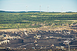 A coal mine in Northwesten Czech Republic and in the background, 4 wind turbines. The coal and fossil fuel lobby in the Czech Republic is very strong and making it difficult to move towards renewable energy.
