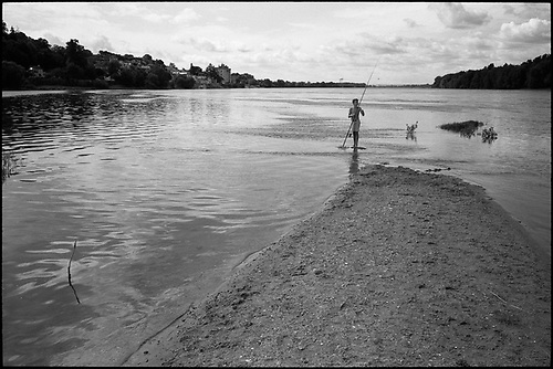 Boy Fishing, Candes Saint Martin, France by Paul Cooklin