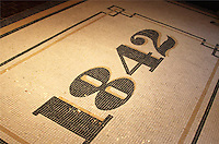 Custom entry address rug shown in polished stone mosaic.