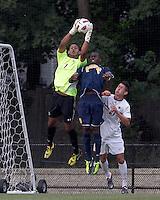Boston College goalkeeper Justin Luthy (1) and Quinnipiac University forward Machel Baker (8) battle for the ball. Boston College defeated Quinnipiac, 5-0, at Newton Soccer Field, September 1, 2011.