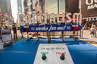 """Capitalism Works For Me!. an interactive sculpture by the artist Steve Lampert is displayed in Times Square in New York on Friday, September 20, 2013. Visitors get to vote """"yes"""" or """"no"""" with their choice counted on a digital readout on the artwork. The piece attempts to engage passerby in a public forum about the U.S. economy, in the middle of a hotbed of advertising and capitalism itself. The artwork will also be on display Oct. 6-9, Noon to 7PM. (© Richard B. Levine)"""